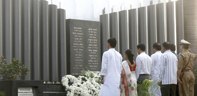 People pay tribute at the Police Gymkhana memorial marking the November 26, 2008 attacks in Mumbai y