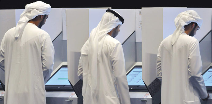 People vote at a polling station in Abu Dhabi yesterday.