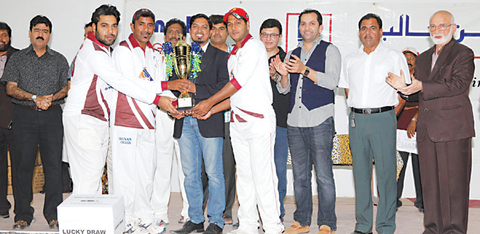 Skipper Khader of Hanan receiving the winners' trophy from Saquib Raza Khan, Deputy General Manager