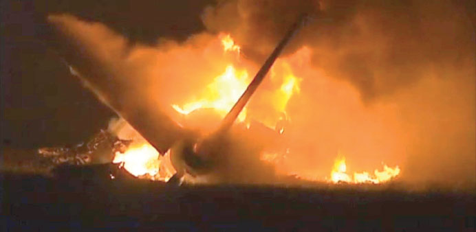 Flames rise from a UPS Airbus A300 cargo plane which crashed near the airport in Birmingham, Alabama