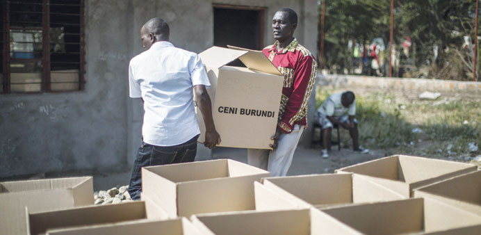 Burundians carry boxes of electoral material in the Cibitoke suburb of Bujumbura.