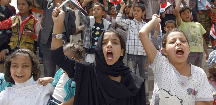Children shout slogans during a protest in Sanaa over the conflict in Yemen yesterday.