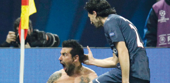 Paris St Germain's Lavezzi celebrates with teammate Pastore after scoring a goal during their Champi