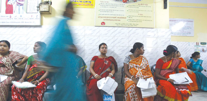 Pregnant women holding their prescription papers wait to be examined at a government-run hospital in