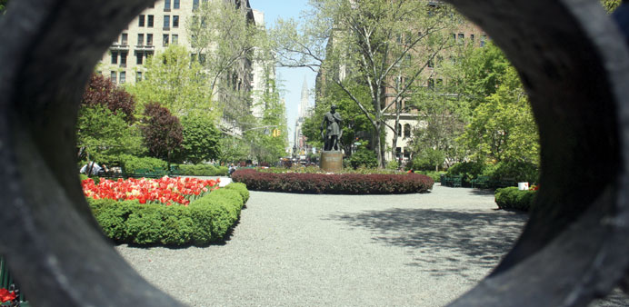 * Gramercy Park, a gated private park and oasis of calm in New York City, seen through its wrought-i