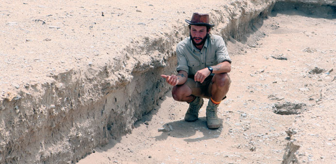 Spencer in Trench 53 at Wadi Debayan archaeological site.