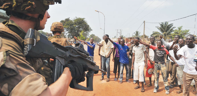 Civilian supporters of the anti-balaka Christian militia challenge French soldiers – part of the San