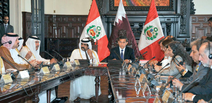 HH the Emir Sheikh Hamad bin Khalifa al-Thani and  Peru's President Ollanta Humala take part in a me