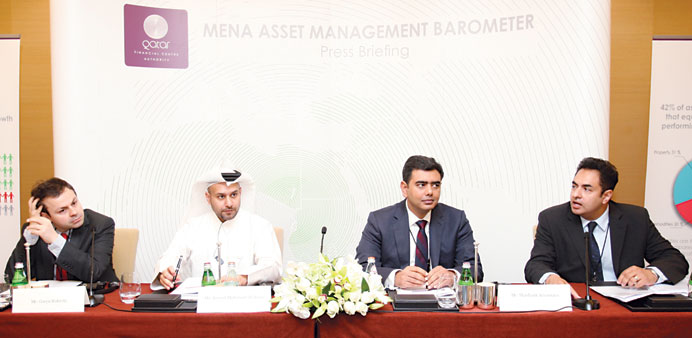 "Srivastava and al-Jaida among others giving details of the ""Mena Asset Management Barometer"" in Doha"