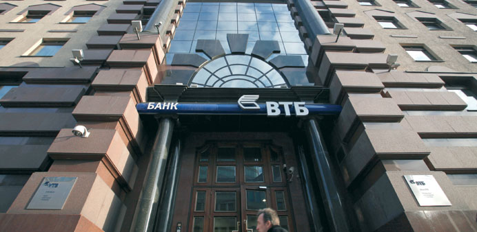 A pedestrian passes the headquarters of VTB Group in Moscow (file). Russia's second-biggest lender h