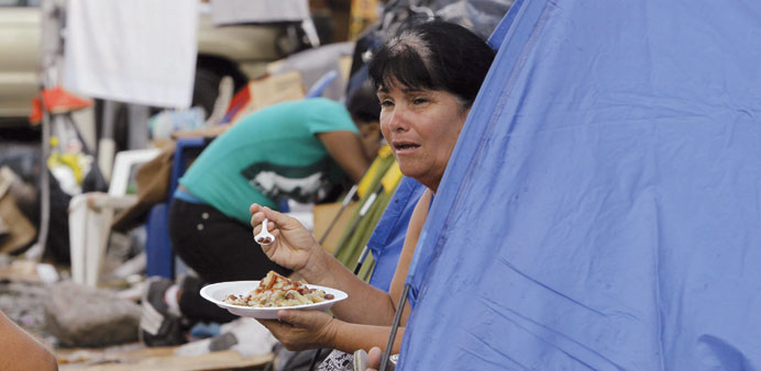 A Cuban migrant eats in a make shift camp at a border post with Panama in Paso Canoas.