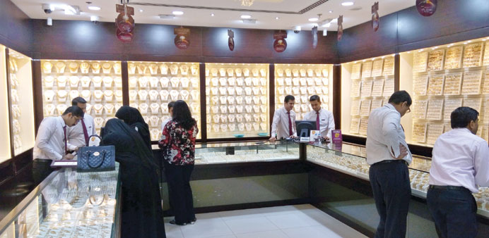 Customers view jewellery at a gold shop. PICTURE: Peter Alagos