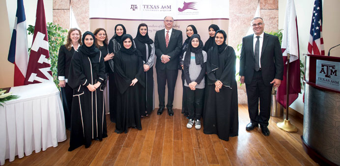 Aisha Alfardan and Dr Mark H Weichold with other officials.