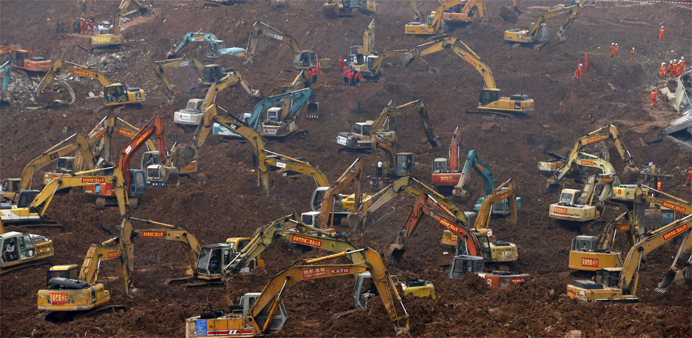 Excavators are seen during rescue operations at an industrial estate hit by a landslide in Shenzhen,