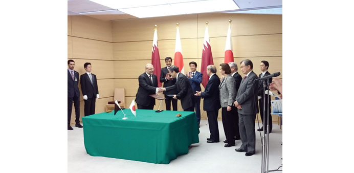HH the Emir Sheikh Tamim bin Hamad al-Thani and Japanese Prime Minister Shinz? Abe at the agreement