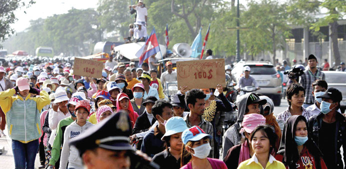 Garment workers march along a street near Prime Minister Hun Sen's office during a protest in centra