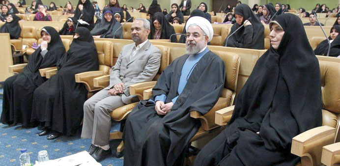 Iranian President Hassan Rohani attends the Women's Day conference yesterday.