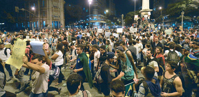 Demonstrators protesting in Belo Horizonte, Brazil, against higher public transport fares and the us