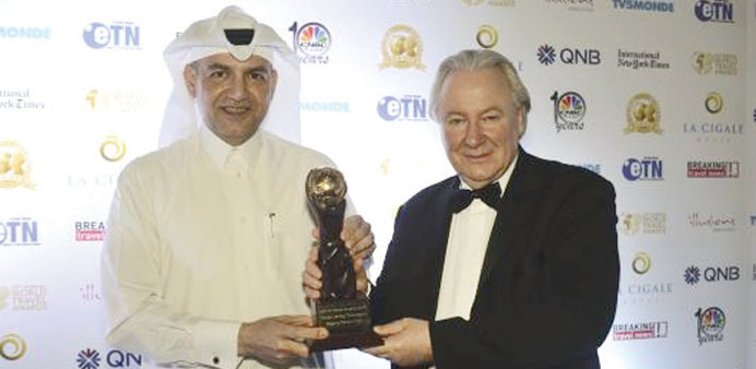 Tareq Abdullatif Taha receiving the award from Graham E Cooke, president of the World Travel Awards.
