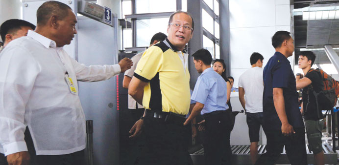 Philippines President Benigno Aquino conducts an inspection at an airport in Pasay city, south of Ma