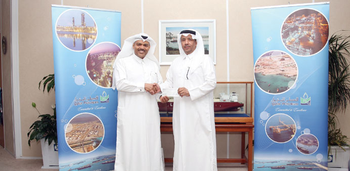 The cheque was presented by Abdulrahman Abdulla al-Obaidly to Brig Mohamed Saad al-Kharji