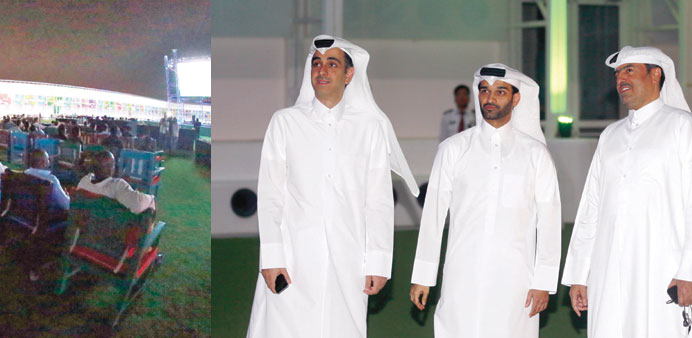 Visitors at the fan zone. Right: Al-Thawadi with other officials at the venue.