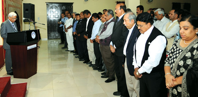 Sanjiv Arora and members of the community observing a moment of silence yesterday for the victims of