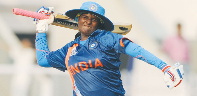 India's Thirush Kamini celebrates her century during the inaugural match of the ICC Women's World Cu