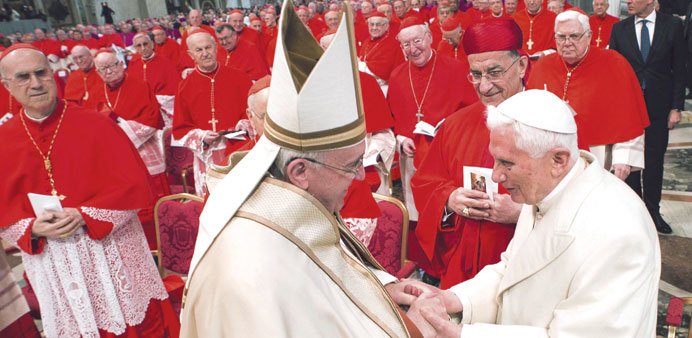 Pope Francis greets Emeritus Pope Benedict XVI during a mass to create 20 new cardinals during a cer