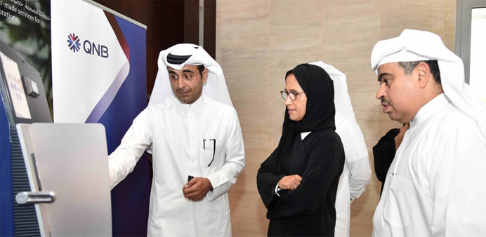 HE al-Jaber along with al-Kuwari (right) viewing iris recognition technology, to be deployed at QN