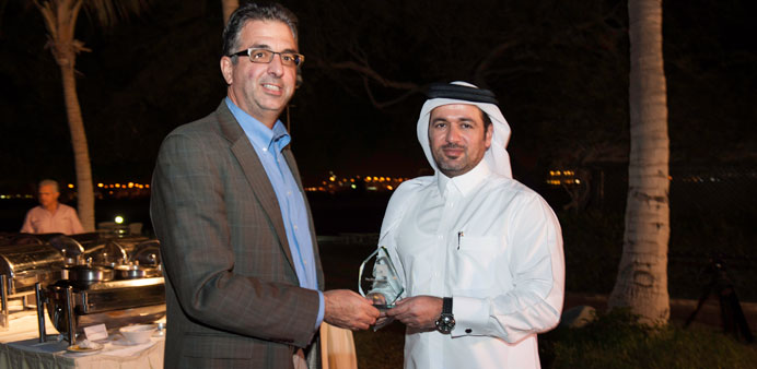 EiP chairman Prof Dimitri Christakis presents a plaque to Khalid al-Mohannadi.