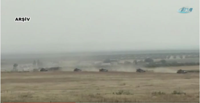 Armoured vehicles of the Turkish army moving along Daglica region. Image grab from a video uploaded