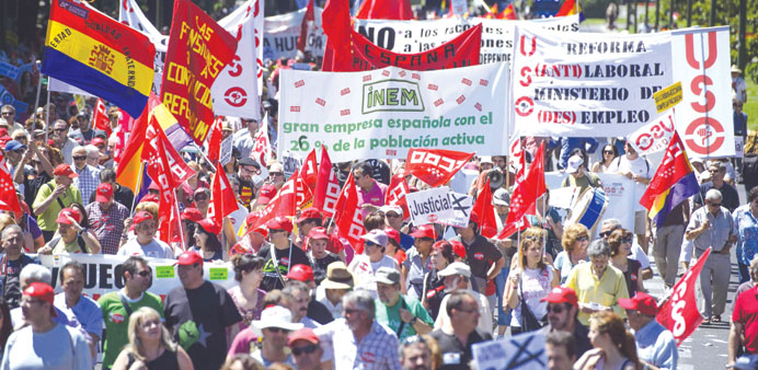 People taking part in a demonstration in Madrid against the government's austerity policies.