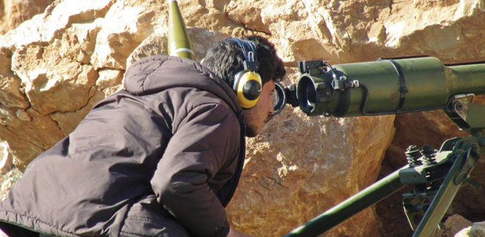 A Free Syrian Army fighter looks through a weapon in Sheikh Najjar in Aleppo in this picture taken o