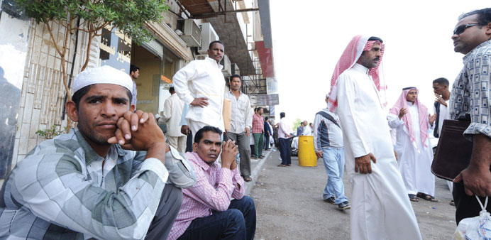 Foreign workers outside the Saudi immigration department waiting for an exit visa.