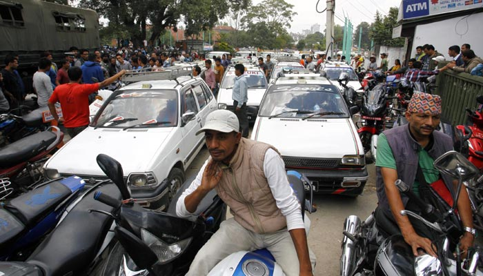 Motorists line up outside a gas station as fuel rations  implemented in Kathmandu, September 28, 201