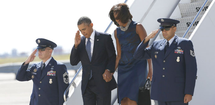 President Barack Obama and first lady Michelle Obama arrive in New York, where Obama will attend the