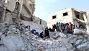 Civil defense members and civilians search for survivors under the rubble- Kafr Takharim, in Idlib