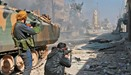Syrian fighters take position during their advance in Aleppo
