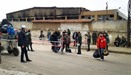 Rebel fighters and their families evacuate the Waer district in the central Syrian city of Homs