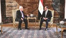A handout picture shows Egyptian President Abdel Fattah al-Sisi meeting with Palestinian leader Mahm